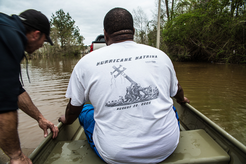 Covington Louisiana, March, 12, 2016,  Norris Willaims leaves Tallow Creek in a friends boat as waters continued to rise.  evacuate the Tallow Creek subdivision by boat Saterday afternoon.14 inches of rain fell in less than 24 hours, after three days of intermittent rain, causing flash floods. The Tchefuncte River and Bogue Falaya River<br />  crested on Saturday morning but the flood event continued into the night for those in Tallow Creek.
