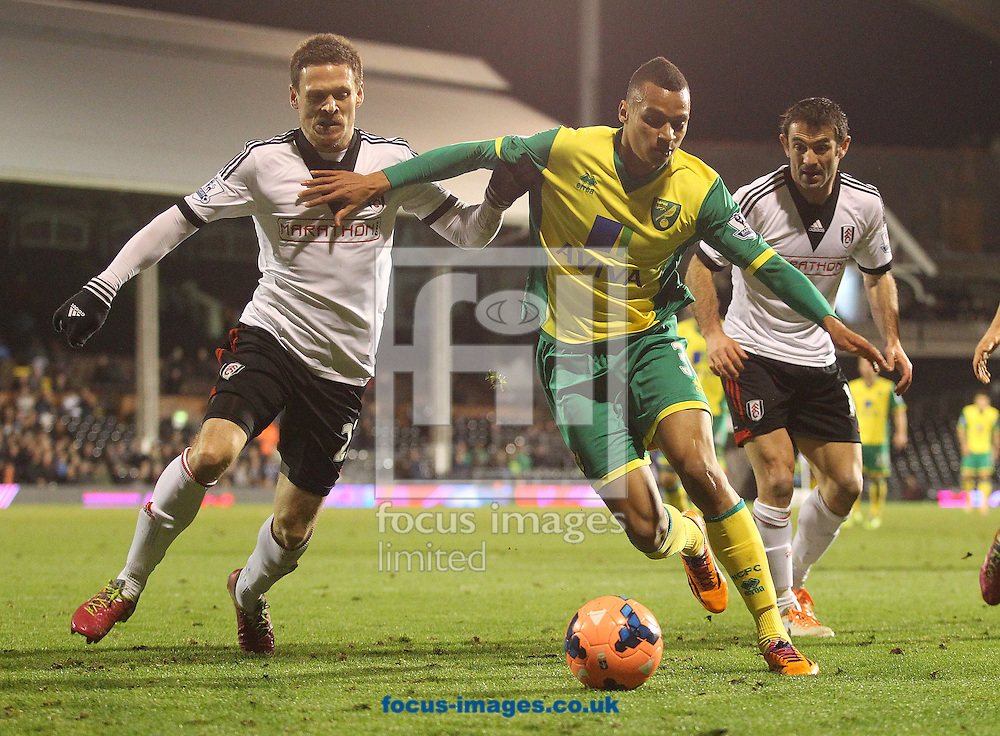 Picture by Paul Chesterton/Focus Images Ltd +44 7904 640267<br /> 14/01/2014<br /> Josh Murphy of Norwich and Sascha Riether of Fulham in action during The FA Cup 3rd Round Replay match at Craven Cottage, London.