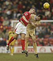 Photo: Aidan Ellis.<br /> Barnsley v Bristol City. Coca Cola League 1. 04/02/2006.<br /> Barnsley's Robbie Williams beats Bristol's Louis Carey to the ball.