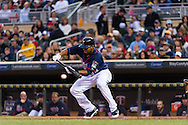 Aaron Hicks #32 of the Minnesota Twins lays down a bunt during a game against the Boston Red Sox on May 17, 2013 at Target Field in Minneapolis, Minnesota.  The Red Sox defeated the Twins 3 to 2.  Photo: Ben Krause