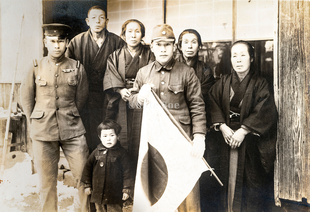 family group phosing with son's in military uniform and Japanse flag ca 1930s