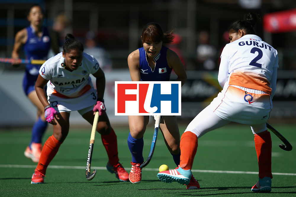 JOHANNESBURG, SOUTH AFRICA - JULY 20: Minami Shimizu of Japan attempts to keep possesion from Deep Ekka of India (L) and Gurjit Kaur of India (R) during the 5th-8th Place playoff match between India and Japan during Day 7 of the FIH Hockey World League - Women's Semi Finals on July 20, 2017 in Johannesburg, South Africa.  (Photo by Jan Kruger/Getty Images for FIH)