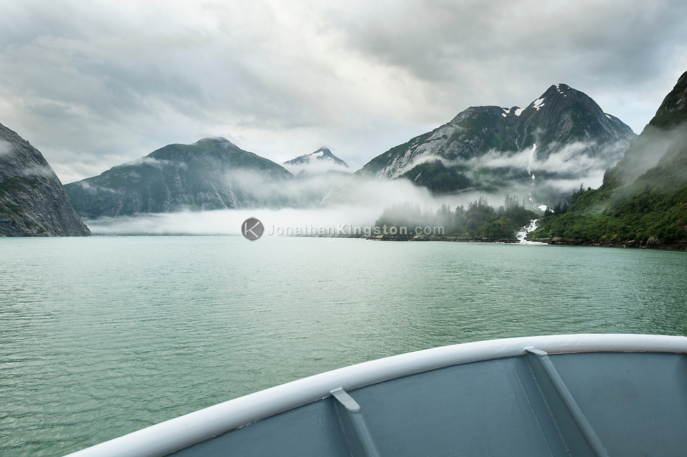 The bow of a small cruise ship in Tracy Arm fjord, Alaska.