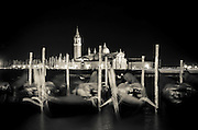 Gondolas and San Giorgio Maggiore church at night, Piazza San Marco (St. Mark's Square), Venice, Veneto, Italy