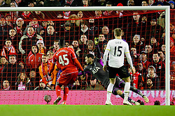Liverpool's Mario Balotelli scores the winning goal 3-2 - Photo mandatory by-line: Matt McNulty/JMP - Mobile: 07966 386802 - 10/02/2015 - SPORT - Football - Liverpool - Anfield - Liverpool v Tottenham Hotspur - Barclays Premier League