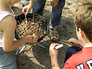 kids playing with matches and fire within a barbecue dish