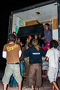 People taking sound equipment out of a lorry at Middle East Tek, Wadi Rum, Jordan, 2008