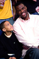 10 December 2006: Ex-Spurs basketball player David Robinson watches the game between the Los Angeles Lakers and the San Antonio Spurs with his son during the Lakers 106-99 victory over the Spurs at the STAPLES Center in Los Angeles, CA.<br />