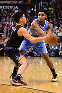 Jan 28, 2017; Phoenix, AZ, USA; Denver Nuggets guard Gary Harris (14) handles the ball against Phoenix Suns guard Devin Booker (1) in the first half of the NBA game at Talking Stick Resort Arena. Mandatory Credit: Jennifer Stewart-USA TODAY Sports