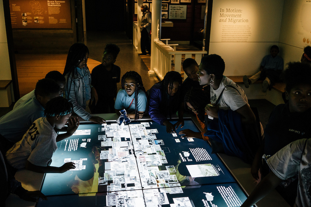 Sixth-graders from Knowledge Is Power Program (KIPP) DC, including Drue Beard, 11, use an interactive display with historic photos inside the Smithsonian National Musuem of African American History and Culture during their visit on Oct 21, 2016. The students spent an hour touring the new Washington, D.C. museum, which is only available to see with reserved tickets during the first year.