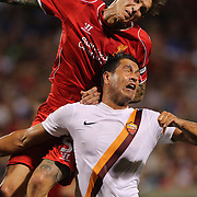 Daniel Agger, Liverpool, wins a header over Marco Borriello, AS Roma, in action during the Liverpool Vs AS Roma friendly pre season football match at Fenway Park, Boston. USA. 23rd July 2014. Photo Tim Clayton
