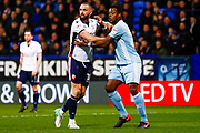 Bolton Wanderers forward Aaron Wilbraham (18) is marked tightly by Sunderland defender Lamine Kone (23)  during the EFL Sky Bet Championship match between Bolton Wanderers and Sunderland at the Macron Stadium, Bolton, England on 20 February 2018. Picture by Simon Davies.