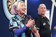Mikuru Suzuki at the end of her first round match with James Richardson during the PDC William Hill World Darts Championship at Alexandra Palace, London, United Kingdom on 15 December 2019.
