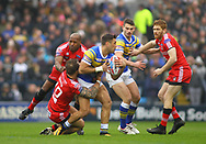 Joel Moon (C) of Leeds Rhinos tackled by George Griffin (L) and Kris Welham (R) of Salford Red Devils during the Betfred Super League match at Emerald Headingley Stadium, Leeds<br /> Picture by Stephen Gaunt/Focus Images Ltd +447904 833202<br /> 02/04/2018