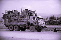 21 August 2005..A woman sit on the road next to a truck loaded with the remaining of the house she left in Waziristan.