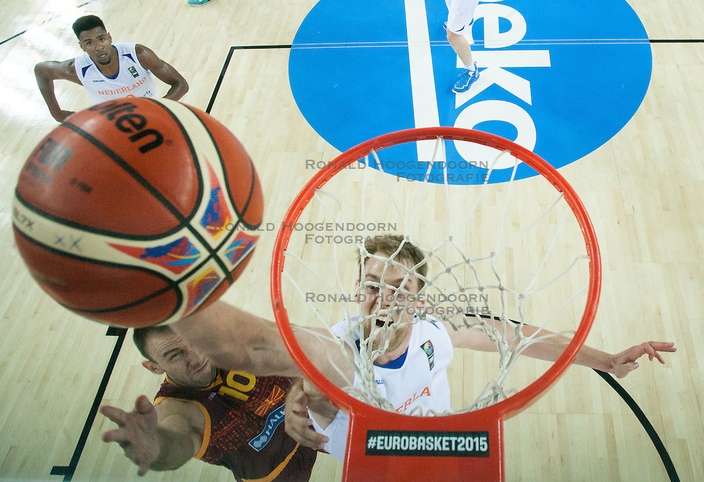 06-09-2015 CRO: FIBA Europe Eurobasket 2015 Nederland - Macedonie, Zagreb<br /> Marko Simonovski of Macedonia vs Henk Norel of Netherlands during basketball match between Netherlands and Macedonia at Day 2 in Group C of FIBA Europe Eurobasket 2015, on September 6, 2015, in Arena Zagreb, Croatia. Photo by Vid Ponikvar / RHF