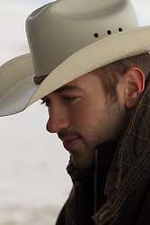 handsome rugged young cowboy outdoors