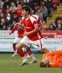 London, England - Saturday, January 12th, 2008:  Charlton Athletic's Zheng Zhi celebrates scoring the third Charlton goal against Blackpool during the League Championship match at The Valley. (Pic by Chris Ratcliffe/Propaganda)