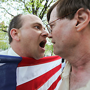 Gay rights advocate Matthew Arnold-Lloyd of Albany, left, clashes with an unidentified man opposed to gay marriage during a rally outside the Capitol in Albany Tuesday, April 28, 2009.
