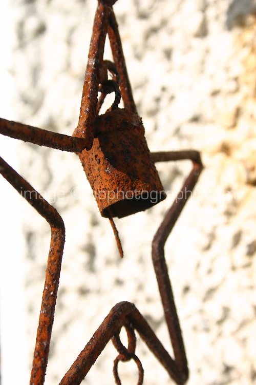 Rusty star wind chime outdoors