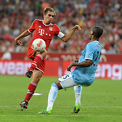 01.08.2013, Allianz Arena, Muenchen, Audi Cup 2013, FC Bayern Muenchen vs Manchester City, im Bild, Philipp LAHM (FC Bayern Muenchen), links gegen FERNANDINHO (Manchester City), rechts FERNANDINHO (Manchester City) // during the Audi Cup 2013 match between FC Bayern Muenchen and Manchester City at the Allianz Arena, Munich, Germany on 2013/08/01. EXPA Pictures © 2013, PhotoCredit: EXPA/ Eibner/ Wolfgang Stuetzle<br /> <br /> ***** ATTENTION - OUT OF GER *****