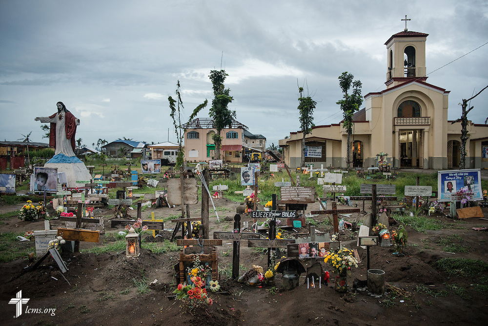 Victims from Typhoon Haiyan are buried in a graveyard in Tacloban, Leyte Province, Philippines, on Friday, March 14, 2014. LCMS Communications/Erik M. Lunsford