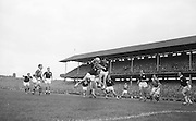 Galway backs this jumps for possession near their own goal during the All Ireland Senior Gaelic Football final Kerry v. Galway in Croke Park on 27th September 1964. Galway 0-15 Kerry 0-10.
