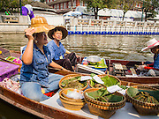 "12 FEBRUARY 2015 - BANGKOK, THAILAND:  A vendor makes ""pad Thai"" a fried noodle dish sometimes called the national dish of Thailand, at the new floating market opened on Khlong Phadung Krung Kasem, a 5.5 kilometre long canal dug as a moat around Bangkok in the 1850s. The floating market opened at the north end of the canal near Government House, which is the office of the Prime Minister. The floating market was the idea of Thai Prime Minister General Prayuth Chan-ocha. The market will be open until March 1.   PHOTO BY JACK KURTZ"