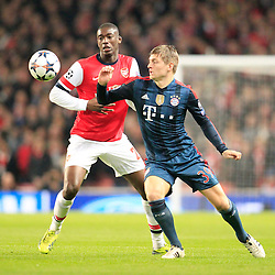19.02.2014, Emirates Stadion, London, ENG, UEFA CL, FC Arsenal vs FC Bayern Muenchen, Achtelfinale, im Bild Toni Kroos (FC Bayern Muenchen #39) im Zweikampf gegen / tackling against Yaya Sanogo (Arsenal FC #22), Aktion, Action // during the UEFA Champions League Round of 16 match between FC Arsenal and FC Bayern Munich at the Emirates Stadion in London, Great Britain on 2014/02/19. EXPA Pictures © 2014, PhotoCredit: EXPA/ Eibner-Pressefoto/ Schueler<br /> <br /> *****ATTENTION - OUT of GER*****