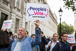 London, UK. 2 September, 2019. Campaigners for a People's Vote attend a 'Stop the Coup' protest in Whitehall as Prime Minister Boris Johnson makes an address to the nation outside 10 Downing Street to the effect that there will be a vote on a general election if MPs vote for a further delay to Brexit.