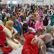 "CHANTILLY, VA - SEP12: Muslims pray at the Dulles Expo Center during Eid al-Adha, the ""Feast of the Sacrifice"", the second of two major holidays in Islam, September 12, 2016, in Chantilly, Vriginia.  The holiday honors the willingness of Ibrahim (Abraham) to sacrifice his son, as an act of submission to God's command. (Photo by Evelyn Hockstein/For The Washington Post)"
