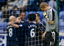 WIGAN, ENGLAND - Sunday, January 20, 2008: Wigan Athletic's goalkeeper Chris Kirkland looks dejected as Everton's Joleon Lescott celebrates scoring the second goal during the Premiership match at the JJB Stadium. (Photo by David Rawcliffe/Propaganda)