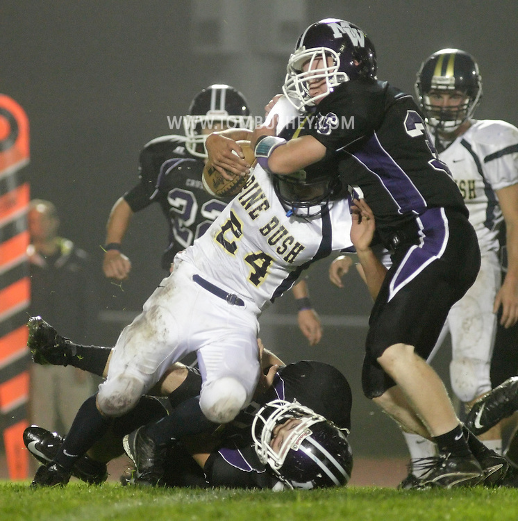 Monroe-Woodbury's Brendan Fee (36) tackles Pine Bush's Brian Guzman during a game in Central Valley on Friday, Sept. 28, 2012.