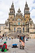 Pilgrims and tourists  in Praza da Obradoiro by Baroque style cathedral, Catedral de Santiago de Compostela, Galicia, Spain