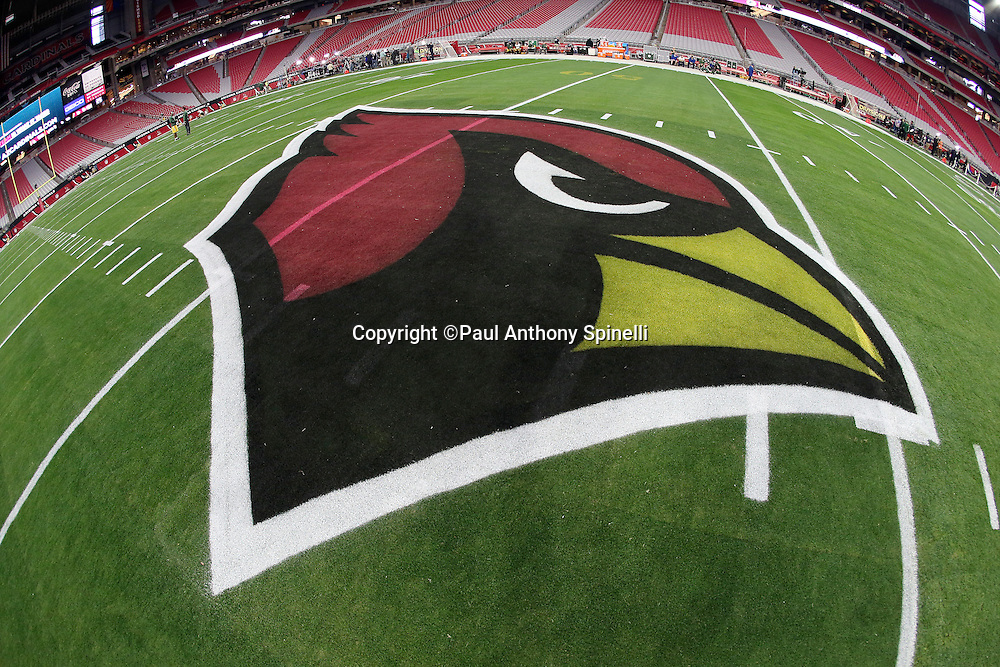 The Arizona Cardinals logo is painted on the field grass for the Arizona Cardinals NFL NFC Divisional round playoff football game against the Green Bay Packers on Saturday, Jan. 16, 2016 in Glendale, Ariz. The Cardinals won the game in overtime 26-20. (©Paul Anthony Spinelli)