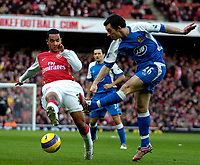 Photo: Ed Godden/Sportsbeat Images.<br /> Arsenal v Wigan Athletic. The Barclays Premiership. 11/02/2007. Leighton Baines (R), clears the ball from Arsenal's Theo Walcott.