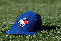 OAKLAND, CA - AUGUST 02: Detailed view of a Toronto Blue Jays baseball hat on a grassy field before the game against the Oakland Athletics at O.co Coliseum on August 2, 2012 in Oakland, California. The Oakland Athletics defeated the Toronto Blue Jays 4-1. (Photo by Jason O. Watson/Getty Images) *** Local Caption ***