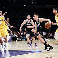 09 January 2018: Sacramento Kings guard Bogdan Bogdanovic (8) drives past Los Angeles Lakers guard Josh Hart (5) and Los Angeles Lakers forward Kyle Kuzma (0) during the LA Lakers 99-86 victory over the Sacramento Kings, at the Staples Center, Los Angeles, California, USA.