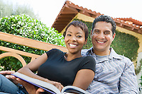 Couple relaxing in back yard, portrait