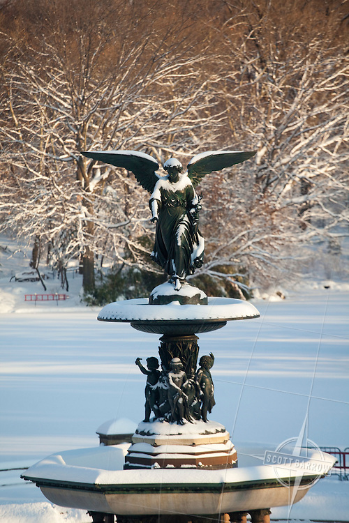 Angel of the Waters at the Bethesda Fountain in Central Park, New York City.  The angel in snow.