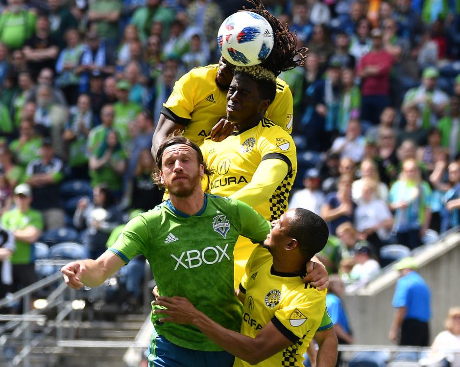 May 05, 2018; Seattle, Washington, US;  Columbus Crew midfielder Ricardo Clark (2) and Seattle Sounders defender Gustav Svensson (4) battle in the box during in action between the Seattle Sounders FC and Columbus Crew at Century Link Field. Photo credit: Rick May - Rick May Photography