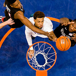 Boise State player James Webb III (23) tips in a basket over defense by San Diego State players Skylar Spencer (0, right) and Malik Pope (21, top left) during the game at Taco Bell Arena in Boise, Idaho. Boise State defeated San Diego State 61-46. Boise State player Robert Heyer (22, left) is also pictured. Sunday February 8, 2015