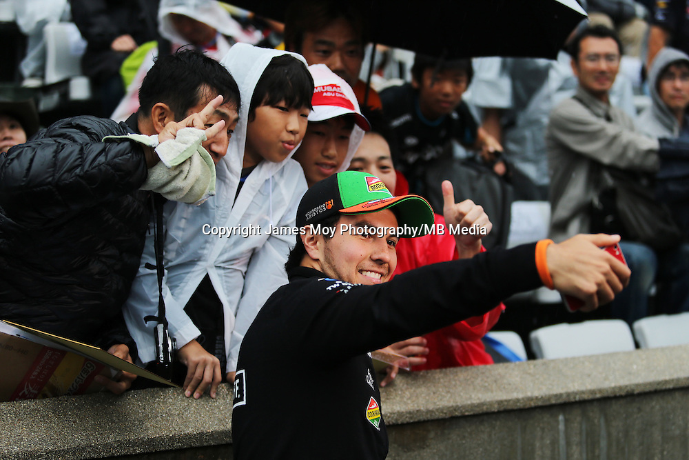 Sergio Perez (MEX) Sahara Force India F1 with fans.<br /> Japanese Grand Prix, Thursday 2nd October 2014. Suzuka, Japan.