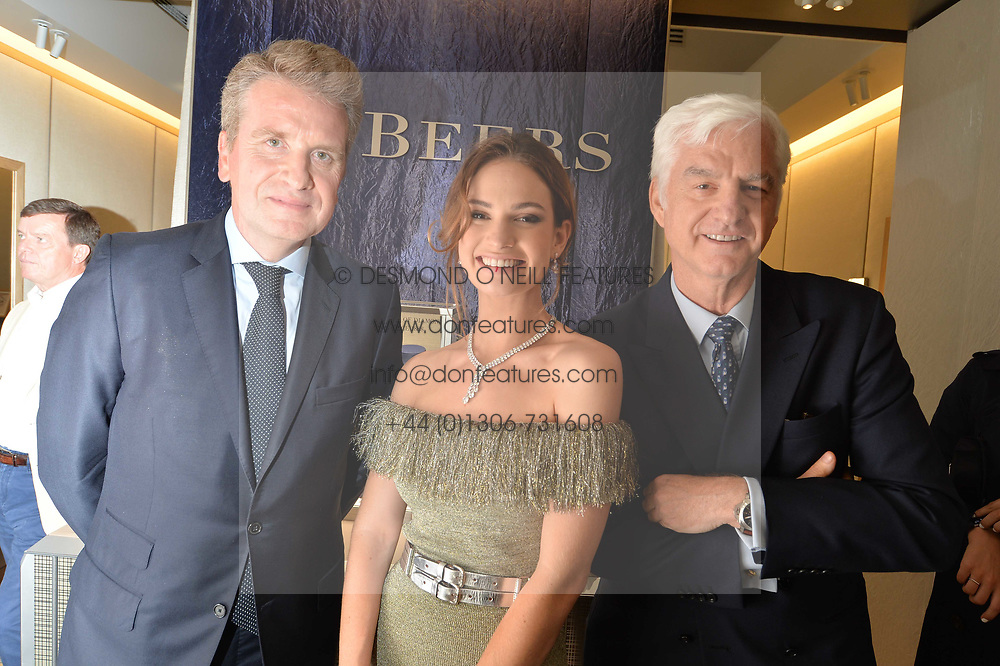 Left to right, Francois Delage, Lily James and Stephen Lussier at a reception to celebrate the opening of the new De Beers home at Harrods , Harrods, 87-135 Brompton Rd, Knightsbridge, London England. 8 June 2017.<br /> Photo by Dominic O'Neill/SilverHub 0203 174 1069 sales@silverhubmedia.com