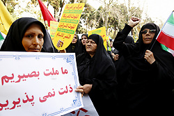 November 4, 2018 - Tehran, Iran - On the eve of renewed sanctions by Washington, Iranian protesters demonstate outside the former US embassy in the Iranian capital Tehran on November 4, 2018, marking the anniversary of its storming by student protesters that triggered a hostage crisis in 1979. Thousands joined rallies in Tehran and other Iranian cities, carrying placards that mocked President Donald Trump, wiping their feet on fake dollar bills, and engaging in the usual ritual of burning the US flag. (Credit Image: © Rouzbeh Fouladi/NurPhoto via ZUMA Press)