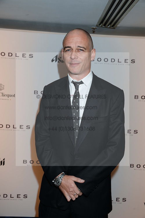 British fine jewellery brand Boodles welcomed guests for the 2013 Boodles Boxing Ball in aid of Starlight Children's Foundation held at the Grosvenor House Hotel, Park Lane, London on 21st September 2013.<br /> Picture Shows:-DINOS CHAPMAN.<br /> Press release - https://www.dropbox.com/s/a3pygc5img14bxk/BBB_2013_press_release.pdf<br /> <br /> For Quotes  on the event call James Amos on 07747 615 003 or email jamesamos@boodles.com. For all other press enquiries please contact luciaroberts@boodles.com (0788 038 3003)