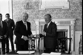 Charles Haughey Receives Seal Of Office.   (T3)..1989..12.07.1989..07.12.1989..12th July 1989..After winning the General Election and having been elected Taoiseach by a majority in Dail Eireann, Charles Haughey went to Aras an Uachtarain to accept the seal of office. The seal of office was granted by President Patrick Hillery...The President and Taoiseach pose for pictures after the official signing.