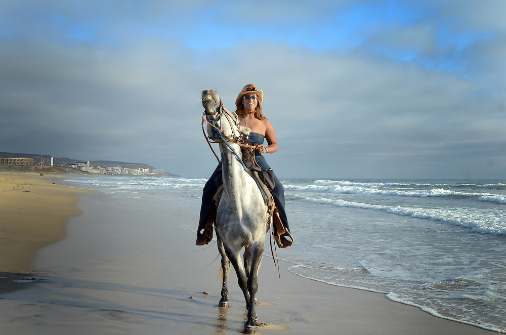 San Diego Lifestyle Photographer Robert Randall Photographs woman and horse at California and Mexico border
