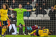 Bernd Leno (GK) (Arsenal) throws his arms up as Sebastien Haller (West Ham) and Calum Chambers (Arsenal) collide in front of him with Matteo Guendouzi (Arsenal) looking on during the Premier League match between West Ham United and Arsenal at the London Stadium, London, England on 9 December 2019.