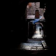 (03/27/2011 JERUSALEM) A lone person runs through the Christian quarter of the Old City  in Jerusalem. [WILLIE J. ALLEN JR.]